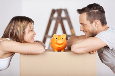 Photo of couple looking at piggy bank